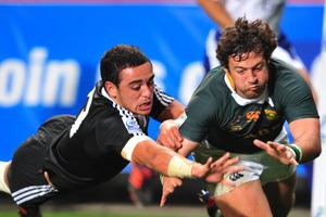 Vian van deer Watt of South Africa scores in the corner despite the efforts of Bryn Hall. Photo / File