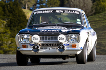 Peter Bryan driving his restored ex-Mike Marshall Ford Escort rally car. Photo / Brad Lord