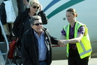 A helping hand for Paul Holmes as he arrives in Napier yesterday. Photo / APN