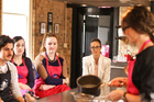 Julia Crownshaw teaches the Weekend Life competition winners expert tips and tricks at Auckland's Main Course Cooking School. Photo / Supplied