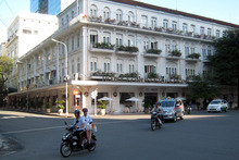 Motorcyclists pass in front of the Continental Hotel in Ho Chi Minh City, Vietnam. The city's colonial-era hotels are a colourful but comfortably up-scale alternative to global accommodation chains. Photo / Suree Pritchard