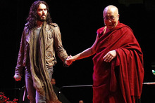 Russell Brand meets the Dalai Lama in Manchester.  Photo / AP