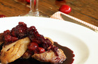 Duck with cherries is the perfect dinner party dish. Photo / Janna Dixon