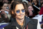 Johnny Depp is single and 'keen to have some fun'.  Photo / AP