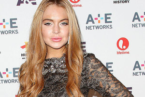Lindsay Lohan has been partying just a day after being treated for exhaustion. Photo / AP