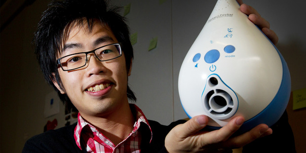 AUT student Mark Wu with a medical humidifier prototype developed for Fisher and Paykel Healthcare. Photo / Sarah Ivey