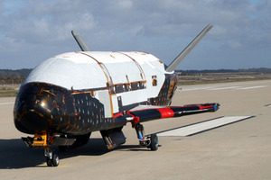 The unmanned X-37B is about a quarter the size of a space shuttle. Photo / AP