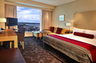 A hotel room at the Sky City Grand, with views out across Auckland. Photo / Supplied