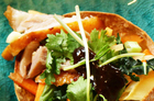 Shredded duck sits atop an Asian-inspired slaw nestled in wonton baskets. Photo / Janna Dixon
