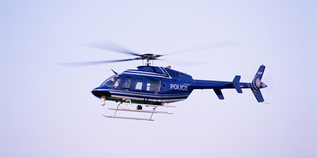 Tactical response officers, dogs and a helicopter equipped with a thermal imaging system are on the hunt for the killer in the Berry Springs area south of Darwin. File photo / Thinkstock
