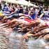 The elite men dive into Schwarzsee lake to begin the 2012 ITU World Triathlon, in Kitzbühel, Austria. Photo / AP