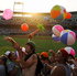 Fans play with beach balls and other inflatable objects in the fourth inning of Game 2 of the NCAA College World Series baseball finals between Arizona and South Carolina in Omaha, Nebraska. Photo / AP