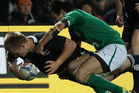 Sam Cane of New Zealand (bottom L) scores a try as he is tackled by Conor Murray of Ireland (C) during their third and final rugby union Test match at Waikato Stadium. Photo / Getty Images.
