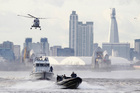 Security forces take part during in a combined security exercise for the London 2012 Olympic Games. Photo / AP