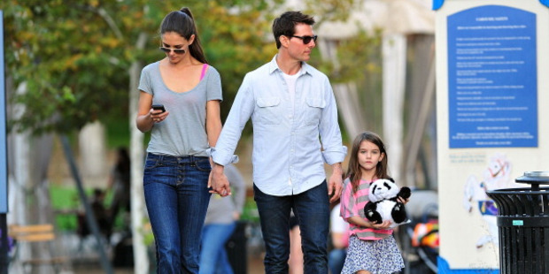 Katie Holmes and Tom Cruise, seen here with daughter Suri, are divorcing.  Photo / AP