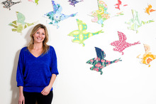 Artist Mariee Guinibert photographed with the flying ducks she sells at the monthly MoAD Design Markets. Photo / Babiche Martens