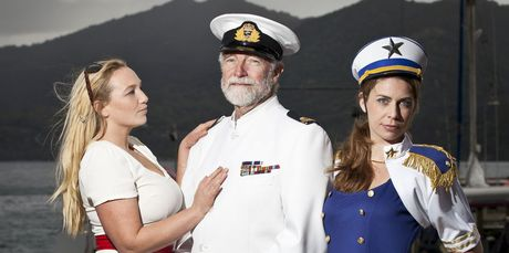 Tryphena netball girls Ebony (left) and Roslyn (right) in Love Boat mode with local board member Richard Sommerville-Ryan, who is dressed as the captain. Photo / Supplied