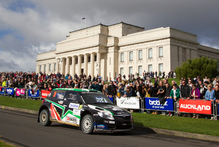 Crowds at the Auckland Domain cheer on Hayden Paddon as he wins his division in a Skoda Fabia S2000. Photo / Greg Bowker