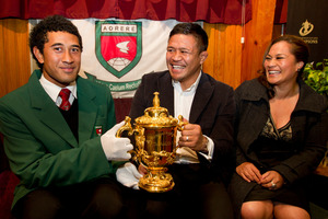 Aorere College 1st XV captain Siosiua Koloto gets his gloved hands on the Webb Ellis Trophy with All Black hooker Keven Mealamu and Black Fern Fiao'o Fa'amausili. Photo / Brett Phibbs