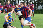 Daniel Lee, Rosmini College hurtles past Logan O'toole and Toby Edgar of Takapuna Grammar during Rosmini's 39-10 win. Photo / Supplied