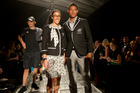 Melody Cooper (centre) and James Musa (right) model the New Zealand Olympic team's formal uniform. Photo / Brett Phibbs