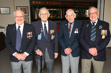 World War II air veterans (from left) Ernest Davenport, Harry Furner, Wally Halliwell and Harry Cammish, pay their respects at Whenuapai. Below: An artist's impression of the London memorial. Photo  / Chris Gorman.