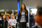 Tayla Young, 13, of Rangitoto College reacts with shock as she is named the New Zealand Flag Envoy to the London Olympics. Picture / Chris Gorman.