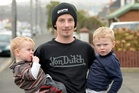 Home unharmed - Benjamin Bryant, 22, holds his sons Jake, 2, and Cooper Wells, 1, who were taken for an unexpected high-speed drive by a drink-driver. Photo / Otago Daily Times