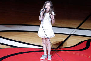 Julia Dale, 11, sings at the NBA finals in Miami. Photo / AP