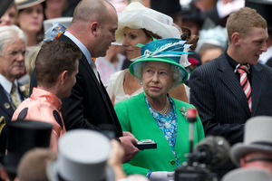 A proud Peter Moody and Luke Nolen (left) discuss their princess of the turf with the Queen. Photo / AP