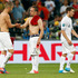 France's Karim Benzema, left, shakes hand with Franck Ribery as their teammate Yohan Cabaye leaves the pitch. Photo / AP.