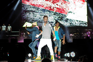 Pop star Justin Bieber, front, performs during a free open-air concert in Mexico City. Photo / AP