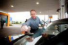 CEO Mike Bennetts helps with service on a Z forecourt. Photo / Dean Purcell