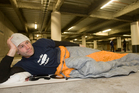 Marc Ellis, bedding down for the night in last year's Big Sleep Out, will give a repeat performance this year. Photo / NZ Herald