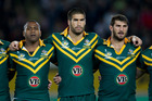 Australia's and ex-Junior Kiwi James Tamou flanked by Akuila Uate and Davis Taylor during the Australian nation anthem, during the rugby league ANZAC test match between the Kiwis and Kangaroos. Photo / Brett Phibbs.