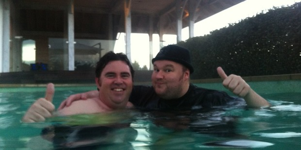 Kim Dotcom (r) pictured with Ben Gracewood during the pool party at the Dotcom mansion organised through twitter this week. Photo / supplied