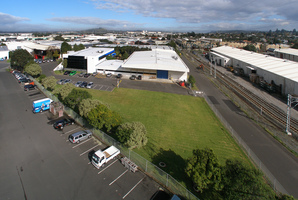 The pharmaceutical company's large office and warehouse complex in the centre of the Penrose industrial zone is for sale.