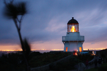 The Awhitu Peninsula lighthouse is lit by candles in a children's mid-winter light-up ceremony. Photo / Roger McCarry