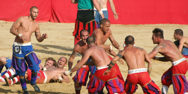 Every year, 54 men strip off their shirts and prepare to be pounded in the football game of Calcio Storico in Florence. Photo / Creative Commons image by Wikimedia user Lorenzo Noccioli