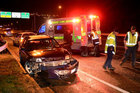 Police at the scene of a car crash on Dunedin's Southern Motorway last night. Photo / Stephen Jaquiery for ODT