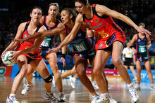 Khao Watts of the Magic grabs the ball ahead of Geva Mentor of the Vixens and Irene van Dyk of the Magic during the round four ANZ Championship match. Photo / Getty Images.