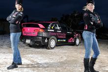 Ramona Karlsson and co-driver Miriam Walfridsson with the Mitsubishi that burnt during Rally New Zealand yesterday.