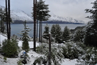 Snow seen over Lake Wakatipu off Glenorchy Road just after 10am this morning. Photo / Carman Hagen