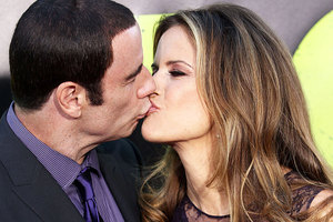 John Travolta kisses wife Kelly Preston on the red carpet at the Savages premiere. Photo / AP