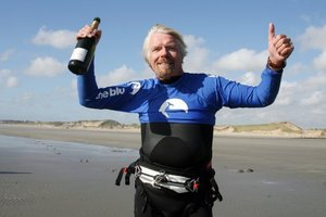 British tycoon Richard Branson, 61, celebrates on July 1, 2012 in Wimereux, northern France, after he succeeded in crossing the English Channel. Photo / AFP