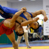 South Korean wrestler Jung Ji-hyun, bottom, trains in preparation for the upcoming London Olympics at the National Training Center in Seoul, South Korea. Photo / AP