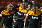 Sona Taumalolo (L) of the Chiefs is congratulated by Sitiveni Sivivatu and teammates. Photo / Getty Images.