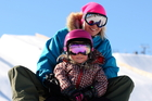 Rug up warm for sledding at Snow Park. Photo / Snow Park NZ/Miles Holden