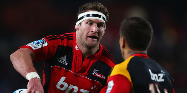Kieran Read of the Crusaders looks to offload the ball during the round 17 Super Rugby match between the Chiefs and the Crusaders at Waikato Stadium. Photo / Getty images.