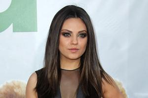 Mila Kunis has denied rumours that she is dating her once on-screen boyfriend Ashton Kutcher. Photo / AP